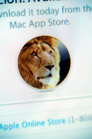 os: Paris, France - September 11, 2011: Apple web page displaying OS X Lion Operating System logo on the Apple website. OS X Lion is the new OS system from Apple and it shows  many new developments, as an easily navigable display of installed applications, to