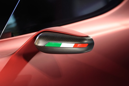 Rearview car driving mirror on an a red italian supercar. Useful file for your brochure about transportation, automotive industry and road safety Stock Photo - 12251318