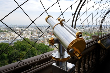 Telescope on top floor of Eiffel Tower in Paris, France. Useful file for your brochure, flyer or website about France sightseeing. photo