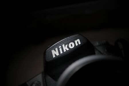 macro photography: Paris, France - February 11, 2012: Nikon logo on a DSLR body. Nikon Corporation - the multinational corporation headquartered in Tokyo, Japan announces a new 36.3 megapixel FX-format professional D-SLR, the Nikon D800. This new camera delivers unprecedent Editorial