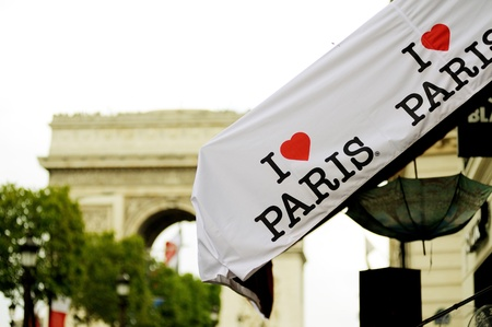 PARIS - JULY 13: I Love Paris awning on avenue Champs-Elysees in Paris, France. Picture shows the famous I LOVE PARIS logo from the city of Paris, printed on a window protection material.
