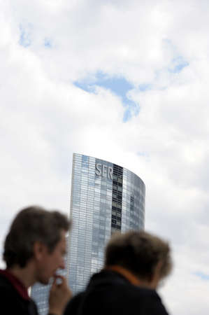 incidental people: People passing in front of SFR headquarter, Paris