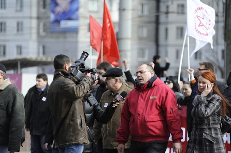 voronin: Alexander Petkov, deputy from the Communist Party giving an interview to the pro communist tv station NIT during the march of 10 thousand people during the march of against the current administration and president elections. Chisinau, Republic of Moldova.