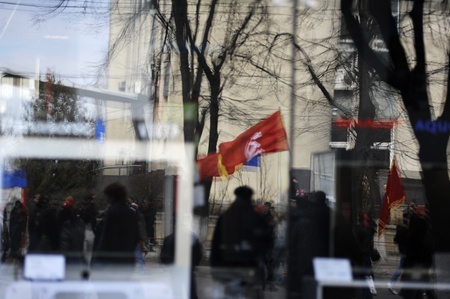 voronin: Reflection of the Communist Party flag during the march of approximatively 10 thousand people who protest against the current administration and president elections.
