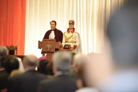 Constitution Court Chairman Alexander Tanase reading out the Court�s decision which validate the presidential elections results next to a guard who presents the presidential necklace.   Stock Photo - 12779059