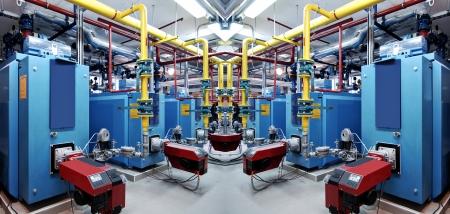 Interno di camera indipendente moderne apparecchiature caldaia a gas per il riscaldamento del sistema con manometri, valvole, pompe e termo-isolanti su tubazioni.