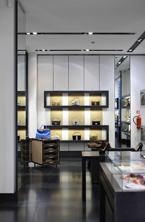 Interior of a boutique store with fashionable luxury women bags and shoes  Useful file for your new mall boutique, VIP store or brand magazine  Editorial