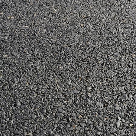 Nieuwe warm asfalt abstracte textuur backgroun. Nuttig bestand voor uw brochure, folder en site over de aanleg van wegen, stedelijke diensten en andere behoeften Stockfoto