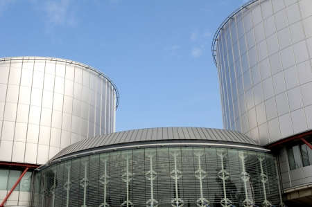 European Court of Human Rights (Palais des Droits de l'Homme) distinctive shape in Strasbourg, Bas Rhin, France. The building, which evokes the balance of Justice, was designed by British architect Richard Rogers and inaugurated in 1995. Useful file for y Editorial