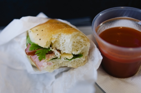 Hamburger and tomato juice as the main prepared for economy class airline passengers  Useful file for your article about eating on plane, tranposrtation brochure and other media needs  photo
