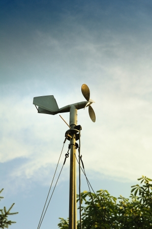 meteorological: A windmill style of anemometer - such weather monitoring devices as tje anemometer was developed in 1926 and remains widely used for the wind speed measurements  Useful file for your brochure about weather, ecology and other media needs Stock Photo