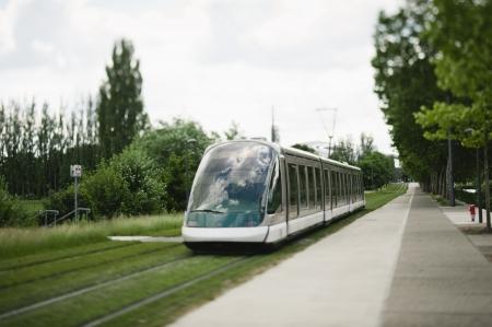 Modern tramway passing near the European Parliament in strasbourg, France. Redakční