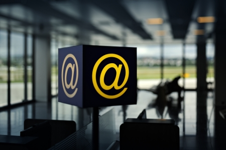 Internet sign inside Airport with businessmen sitting on waiting benches for the flyght. Useful file for your travel flyer, telecommunication brochure or intenet site.