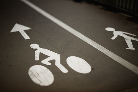 White painted sign for bikes and pedestrian lanes. Stock Photo - 14558135
