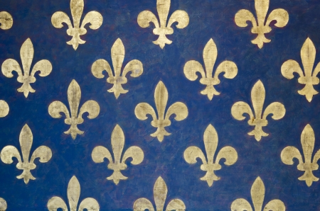 florence italy: Fleur-de-lis Pattern painted on a wall in Palazzo Vecchio - a museum in Florence, Italy  It is one of the oldest and most famous art museums of the Western world