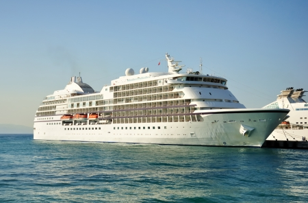 docked: Cruise ship docked at berth in a port Stock Photo