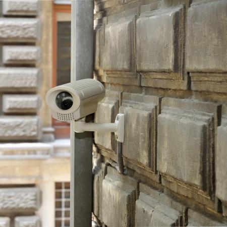 Surveillance camera on brick wall Stock Photo - 17723613