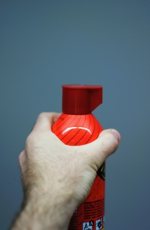Hand holding extinguisher Stock Photo - 18295407