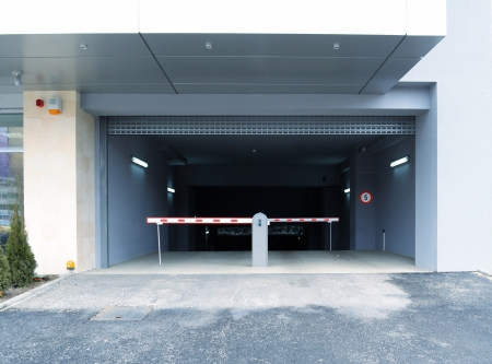electric automobile: Barrier gates entrance to underground parking