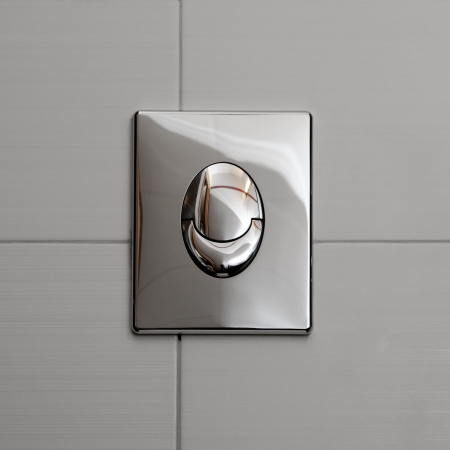 Economic toilet flush knob with two separate buttons  Grey tiles background