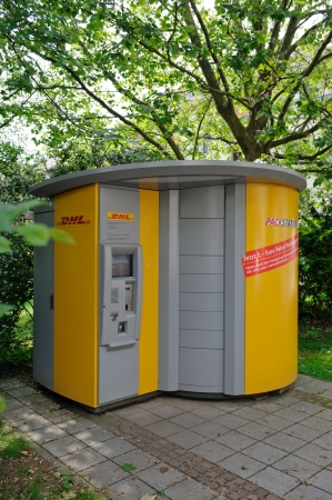 DHL Packstation  The PACKSTATION is an automated system developed by DHL for picking up and self-service dispatch of Pakets and operates as a self-service pick-up station for post, parcels and other oversized post objects  These stations are open 24 hours Stock Photo - 18799234