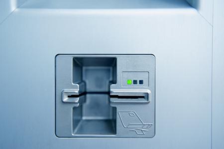 Empty ATM cash point slot with subtle blue cast Standard-Bild