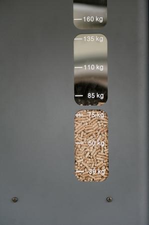 Modern stove using ecological alternative fuel - wood pellets. photo