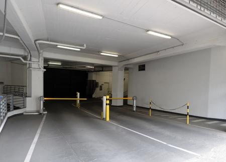 barrier gate: Entrance ramp to underground parking garage Editorial