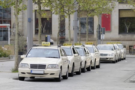 Taxis lined up on sidewalk