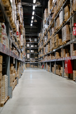 warehouse storage: Large and tall full warehouse full of boxes and goods
