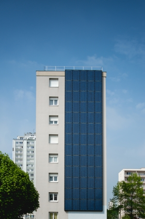 Renewable, alternative solar energy, photovoltaic cell - sun-power plant on a living building.