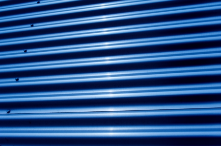 netlike: Corrugated iron structure in blue tonal color Stock Photo