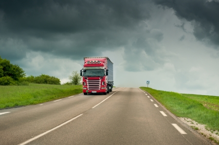 Truckon highway on a stormy weather photo