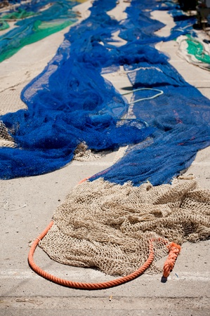 Fishing nets and rope  blue and green nylon  in port  Selective focus on foreground