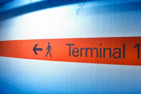 Informational sign on red stripe showing terminal number  one  at international airport Stock Photo - 20753297