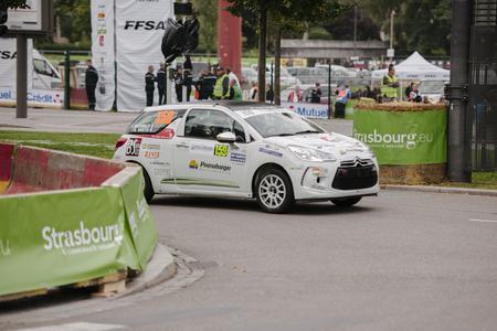 frederic: ESTRASBURGO, Francia - 03 de octubre: Frederic Hauswald de Francia compite en Citro�n DS3 R1 durante el S�per Especial 1 del WRC Francia el 3 de octubre de 2013 en Estrasburgo, Francia.