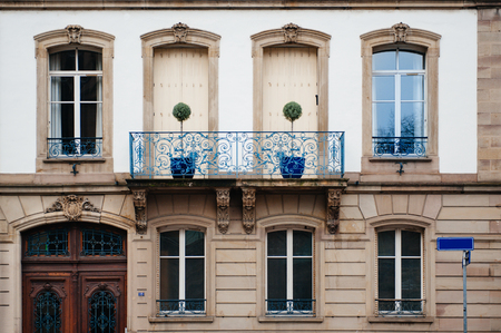 Facade building of a luxury mansion in Strasbourg, with beautiful France balconies - a trully parisian architecture Standard-Bild