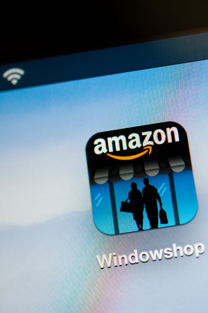 amazon com: NEW YORK - NOVEMBER 13  Amazon Widnowshop on a tablet PC on November 13, 2013  Amazon com has struck a deal with United States Postal Service, to deliver deliver the company's packages on Sundays Editorial