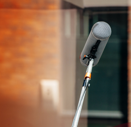Microphone retro on colored baground in concert hall or conference room photo