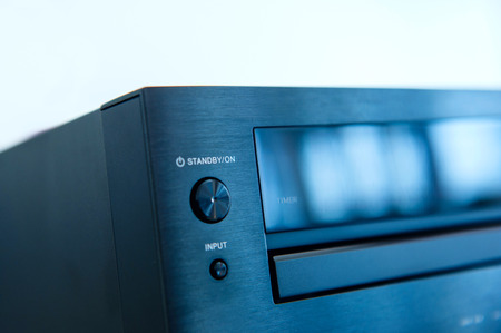 Audio system detail - input and stand by button. Blue technologial color cast and tilt-shift lens used photo