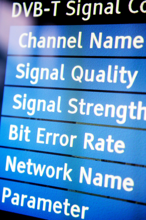 signal strenght: Signal quality menu on a modern television set showing channel name, signal quality, signal strenght, bit error rate, network name and paramenter variables