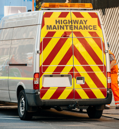 Highway maintenance van with security yellow and red stripes photo