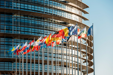 The European Parliament building in Strasbourg, France with flags waving on a spring evening Archivio Fotografico