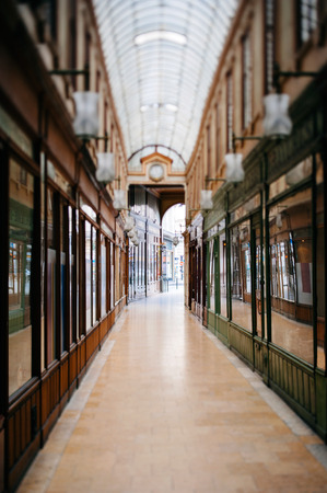 Beautiful Parisian shopping gallery - tilt-shift lens used to accent the path to the entrance and to emphasize the attention it