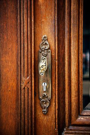 door knob: Close up of vintage antique door handle on the old wooden door. Stock Photo