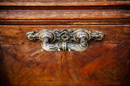 Door handle in vintage style on a old wooden door photo