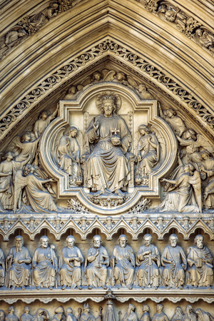 collegiate: London Westminster Abbey main entrance - architectural detail of the doorway bas relief with all the Saints and