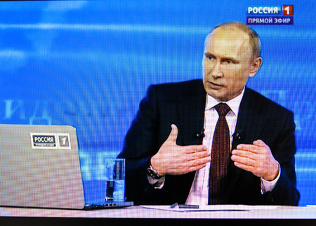 televised: PARIS, FRANCE - APRIL 17, 2014: Russian President Vladimir Putins annual televised call-in with the nation as seen on a digital display. Putin urged dialogue between Russia and Ukraine on APR 17, 2014