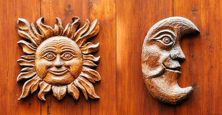 polychromatic: Sun and Moon profiles - ancient carved wooden door