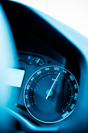 Speedometer close-up with the needle pointing a high 140 km/mph speed Stock Photo - 27724556